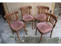 Four vintage bentwood cafe or bistro style chairs with upholstered seats.