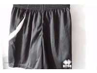 7 pairs black Errea football shorts – perfect for a youth team.