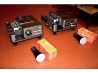 Projectors for 35mm slides. Would separate but buyer who takes them both gets a dissolve unit free