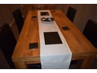 Mango Wood dining table 6ft x 3ft and four faux leather chairs in good condition