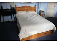 Solid pine wood, double bed frame in great condition, with storage space, mattress included