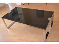black glass coffee table with chrome legs