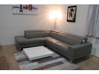 Ex-display Designer Italian taupe leather corner sofa with adjustable headrests