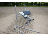 Marcy Olympic weights bench with preacher curl pad, lat pulldown and leg extension attachments. Gym