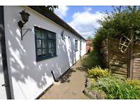 A true gem of a property. This charming bungalow is set in an idyllic private location