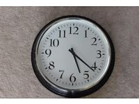 Black Clock with Silver edge and White face