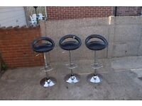 Three Black Plastic Bar Stools
