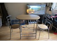 Oval table with 2 chairs(as new)