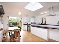 A spacious 5 bed house with 2 bathrooms, parking & south facing garden. Queens Road, Wimbledon SW19