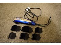electric clippers with guide combs