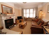 Spacious one double bedroom ground floor flat with sole use of rear garden, close to shops & station