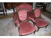 A Victorian stained walnutr three piece salon suite