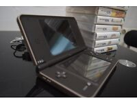 Nintendo DSi XL + 9 Games + more