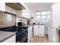 A spacious three double bedroom apartment with a small balcony, situated on Garratt Lane.