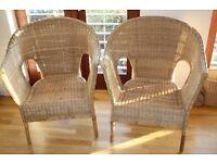 Two wicker basket weave armchairs
