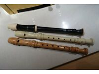 3 descant recorders - one cream, one wood effect, one black