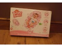 Bright Stars Pink Vibrating Baby Bouncer Chair