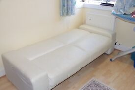 Cream sofa bed in faux leather in excellent condition for quick sale. Used sparingly. For pick up.