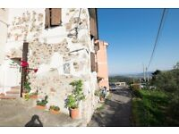 Renovated ancient stone house - working B&B, in ancient italian medival village, close to the see.