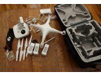DJI Phantom 4 - with 3 batteries extras props