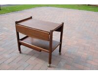 Solid oak tea trolley in excellent condition, with lift up extensions to top and drawer underneath