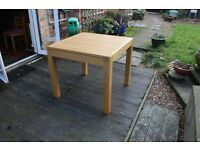 Two extending dining tables