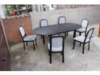 Black Extendable table with six chairs