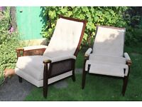 pair of reclining armchairs. 1970's retro design with upholstered back and seat.