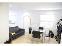 2 bed canalside warehouse conversion, furnished, concierge, walk to station & into Canary Wharf