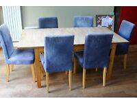 Large solid pine dining table with six solid pine chairs (plus spare chair covers)