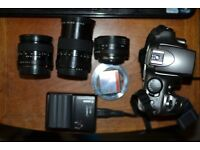 Canon 300d with 3 x carl zeiss lenses , 35mm 2.4 , 50mm 1.8 135mm 3.5