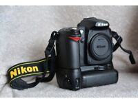 Nikon D 90 body, battery grip, three batteries and charger - excellent condition