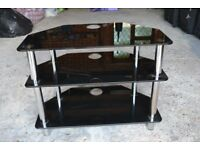 Black, glass TV stand good condition 28 inches wide & 21 inches high.Collect only