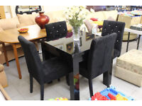 Extendable black dining table and four diamond studded chairs