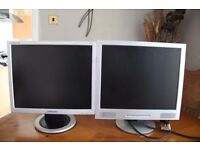 a pair of 19 inch monitors