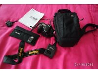 Nikon DSLR D7000 (body only) - used but in excellent condition comes with accesories