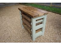Country style kitchen island with storage trays