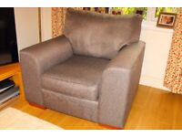 Dark grey material arm chair excellent condition. RE ADVERTISED - TIME WASTERS