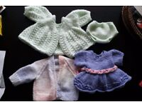 Knitted dolls clothes for larger dolls like Baby Born