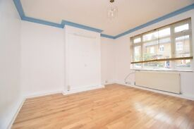 A lovely four bed house with two receptions and off street parking close Woodside Park Station