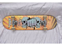 NO FEAR SHULL AND FIST SKATEBOARD