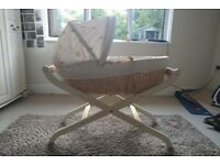 Beautiful Moses Basket, Wooden stand for sale. Barely used. Stand folds.Washable covers on basket .