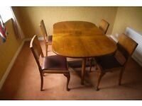 Oval Walnut folding table and 4 chairs 1950's