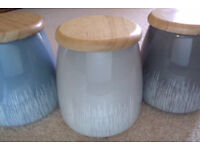 Set of three ceramic containers with lids