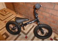 Stompee Balance Bike - Matt Black, Excellent Condition, Adjustable Seat Height And Rear Brake