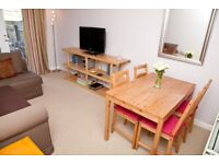Short Term Let - Ground floor flat in modern development with parking and private patio (116)