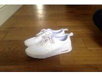 White Nike trainers, new model