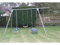 TP Triple metal swing, with swing, skyride, pirate boat (in need of repair) and trapeze extension