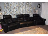 Black DFS reclining leather sofa. Excellent condition. cost £3000 new