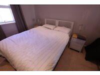 Like-new kingsize white wooden bed frame